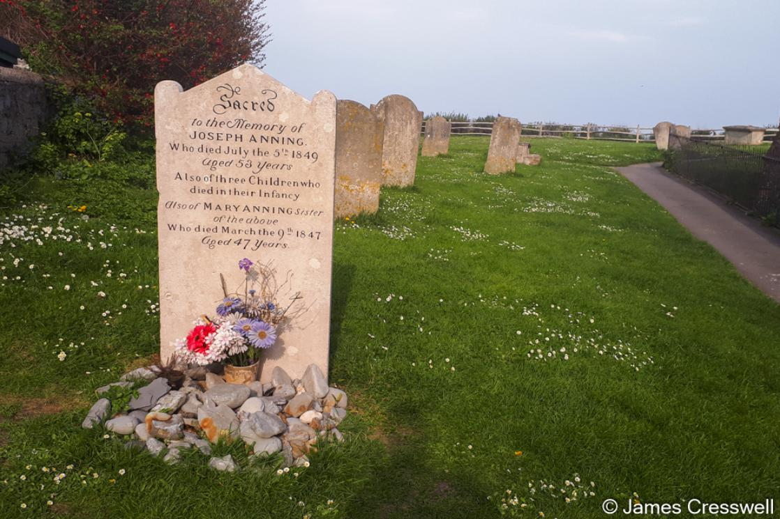 A photograph of the grave of Mary Anning in Lyme Regis, taken on a GeoWorld Travel geology and fossil tour, trip and holiday