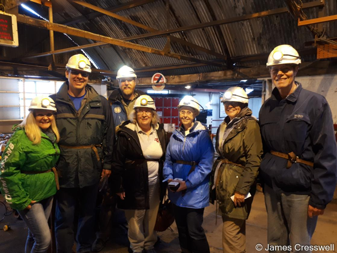 A photograph of a group of people wearing hardhats who are just about to descend the Big Pit, taken on the GeoWorld Travel England and Wales geology trip, tour and holiday