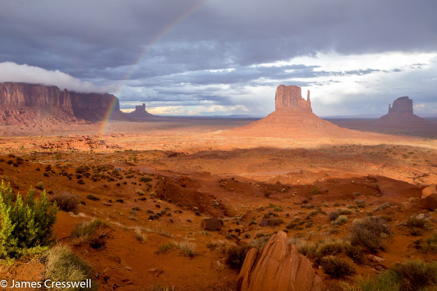 A photograph of rock towers in the desert in Monument Valley taken on a GeoWorld Travel USA geology trip, tour and holiday