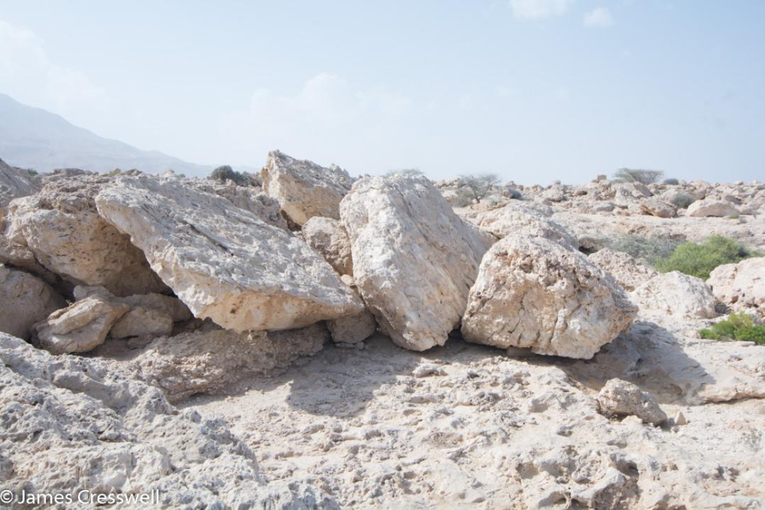 A photograph of stacked up tsunami boulders, taken on a GeoWorld Travel Oman geology trip, tour and holiday