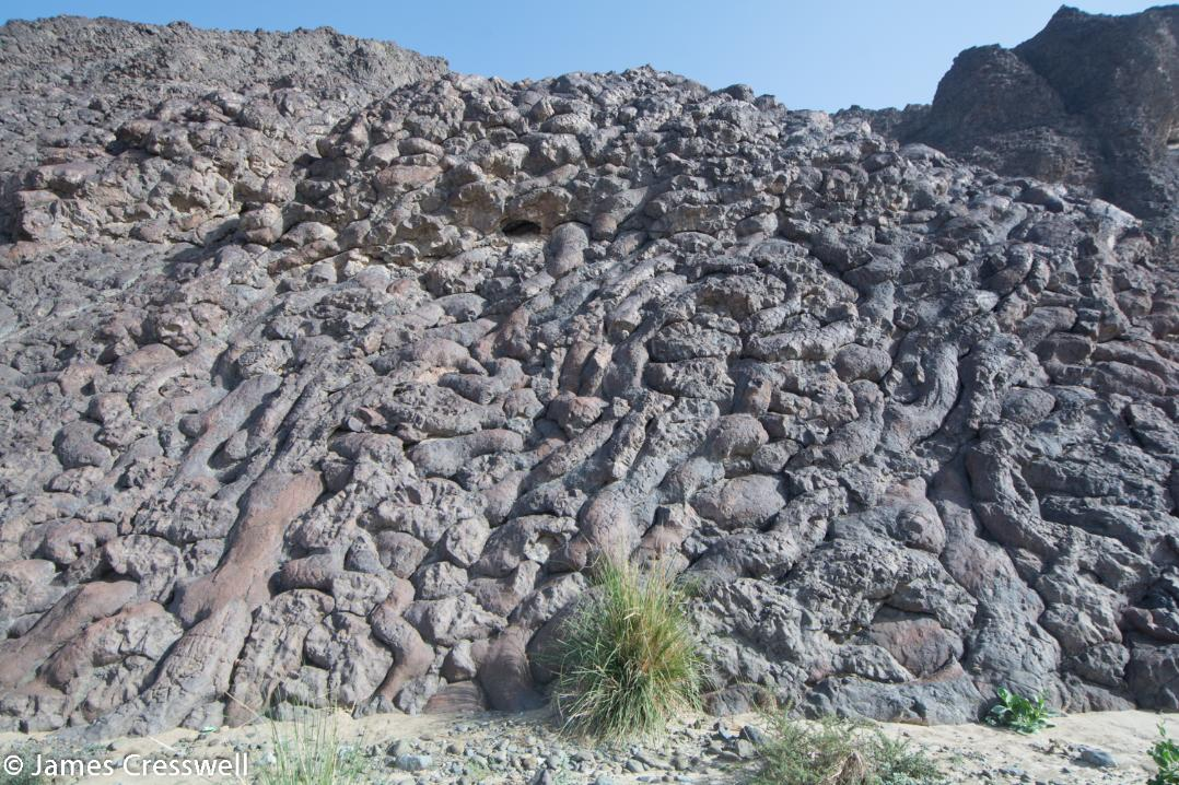 A photograph of the Geotimes pillow basalts at Wadi al Jizzi, taken on a GeoWorld Travel Oman geology trip, tour and holiday