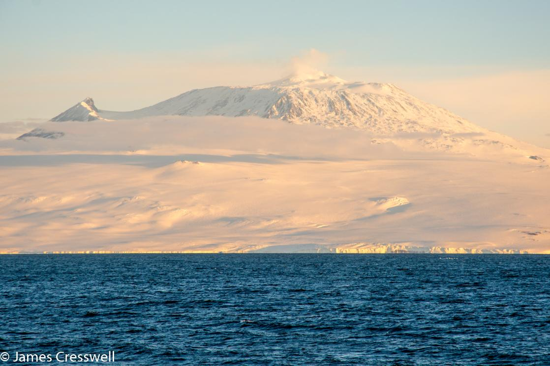 A photograph of Mt Erebus volcano in Antarctica, taken on a PolarWorld Travel placed expedition cruise