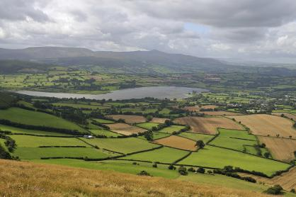 Llangorse Lake as seen from Cockitt Hill was formed in the last Ice Age, GeoWorld Travel geology field trip
